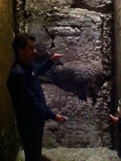 Pietro Ratti showing a cut out in the winery walls with the natural soil exposed