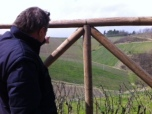 Walter Massa pointing out the Timorasso vineyards